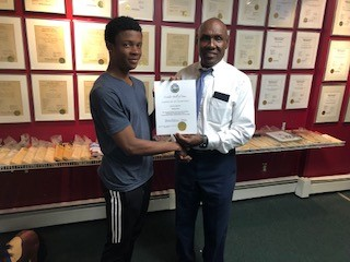 Stephan Pink presented with certificate by Dr. Dolton James